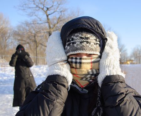 Cold winter woman covering herself from the cold. Stock Photo