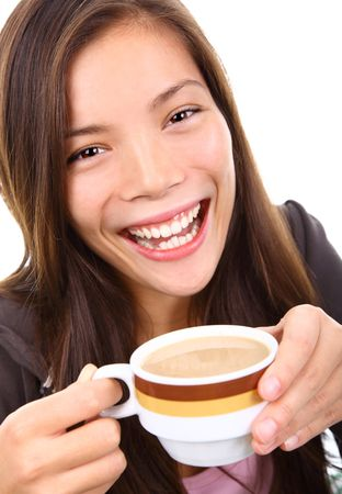 Young woman excited and happy holding her coffee. Isolated on white background. photo
