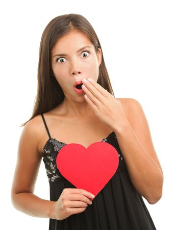 is embarrassed: Woman in shock or embarrassed on valentines day. Isolated on white background. Stock Photo