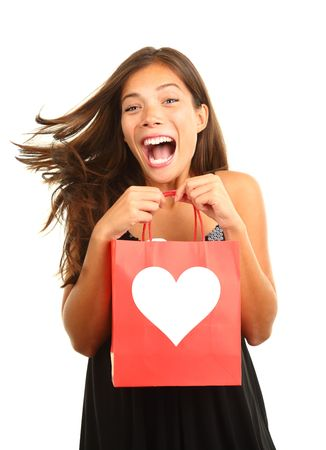 Valentines day woman very happy and excited for her gift  present. Beautiful mixed race asian  caucasian model isolated on white background.  photo