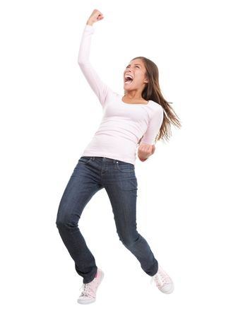 vítězství: Winning success woman in full length cheering and screaming of joy. Casual young mixed race chinese  caucasian isolated in full body on white background.