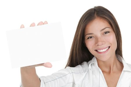 Blank white sign card. Young businesswoman holding white business card / empty paper sign with a lot of copy space. Beautiful mixed race chinese / caucasian woman isolated on seamless white background. Stock Photo - 6156505