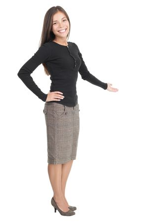 Casual businesswoman welcome gesture. Gorgeous kind looking young mixed race chinese / caucasian woman. Isolated on white background.