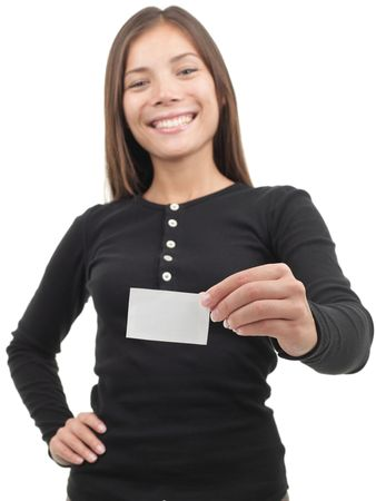 Young casual professional showing blank white business card / paper sign. Beautiful young mixed race chinese / caucasian woman. Isolated on white background. Shallow depth of field, focus on card. Stock Photo - 6179531