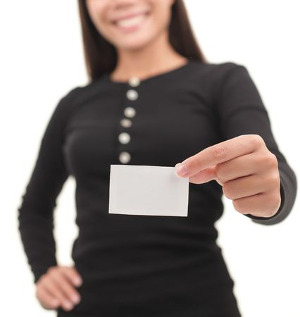 Young casual professional showing blank white business card / paper sign. Isolated on white background. Stock Photo - 6179524