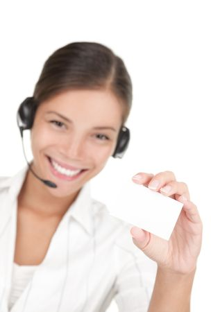 Headset woman holding business card. Beautiful young mixed race chinese / caucasian woman isolated on white background. Stock Photo - 6186249