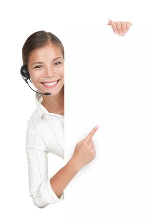 call center people in isolated: Headset woman from call center standing with billboard. Mixed race chinese  caucasian model isolated on white background.  Stock Photo