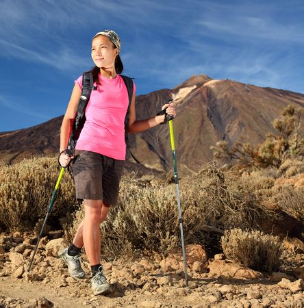 Female hiker. Young asian female model hiking  backpacking in beautiful volcanic landscape on the volcano, Teide, Tenerife, Spain.  photo