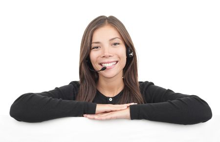 Headset woman from call center leaning over billboard. Isolated on white background.  photo