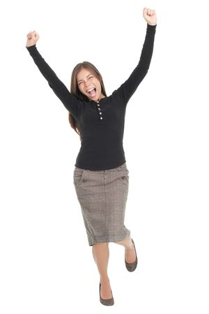 gesturing: Winner woman. Casual young successful businesswoman jumping very excited. Isolated in full length on white background. Stock Photo