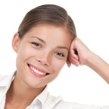 Serene smiling asian woman portrait. White background. Asian  caucasian model. photo