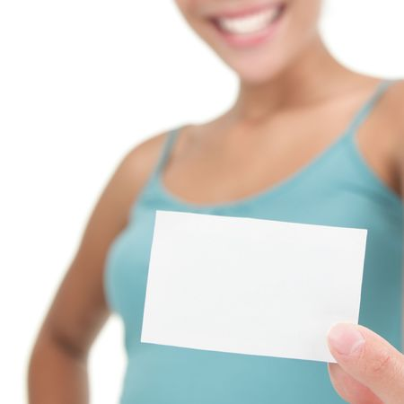 Young casual professional showing blank white business card / paper sign. Isolated on white background. Shallow depth of field, focus on card. Stock Photo - 6244740