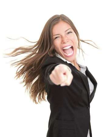 thrilled: Excited young businesswoman pointing at camera. Beautiful young mixed race asian  caucasian woman in suit isolated on white background.
