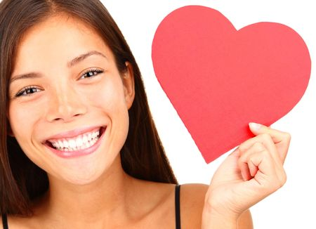 Valentines Day. Woman holding Valentines Day heart sign with copy space. Beautiful mixed race chinese  caucasian model isolated on white background.  photo