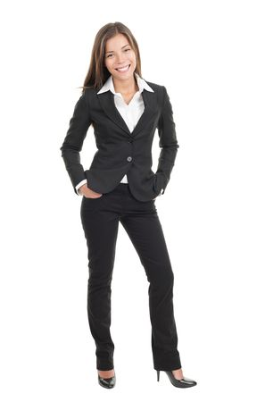 business woman standing: Young beautiful businesswoman isolated
