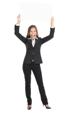 ad sign: Businesswoman holding a white empty banner or sign board in full length while being very happy and excited. Beautiful mixed race chinese  caucasian woman isolated on white background.