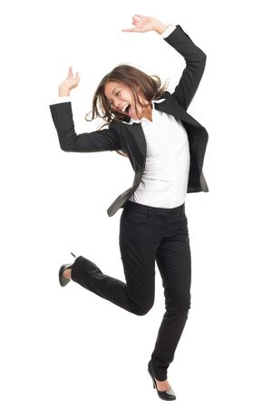 Ecstatic businesswoman in suit dancing. Excited happy asian business woman isolated in full length on white background. Mixed caucasian  chinese model.