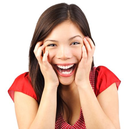 Amazed: Happy cute young woman excited and surprised isolated on white background.