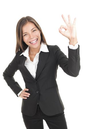 ok symbol: OK sign woman. Businesswoman showing okay hand sign. Successful and beautiful mixed race chinese  caucasian business woman isolated on white background.
