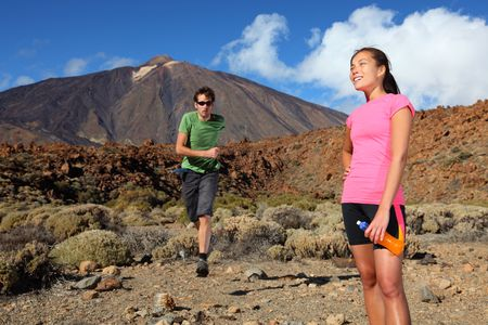 Running. Couple trail running in spectacular volcano landscape on Teide, Tenerife. Stock Photo - 6538295