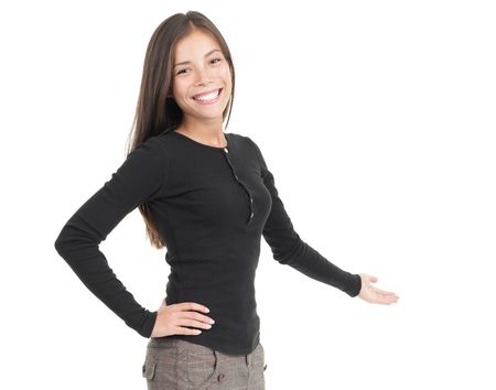 black out: Welcome gesture. Kind and trustworthy looking young mixed race asian  caucasian woman welcoming you. Isolated on white background.  Stock Photo