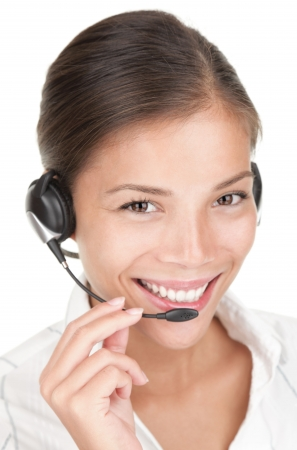 Call center woman with headset. Beautiful smiling mixed race chinese / caucasian woman isolated on white background. Stock Photo - 6538294