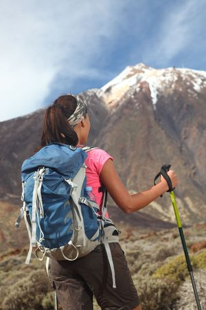 tenerife: Hiking challenge ahead. Sporty woman getting ready for  hiking and climbing challenges on the mountain  volcano Teide on Tenerife. Beautiful woman model.