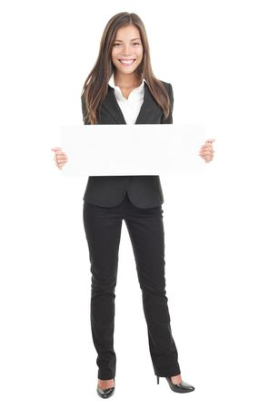 holding arm: Businesswoman holding a white empty banner or poster in full length. Beautiful mixed race chinese  caucasian woman isolated on white background.