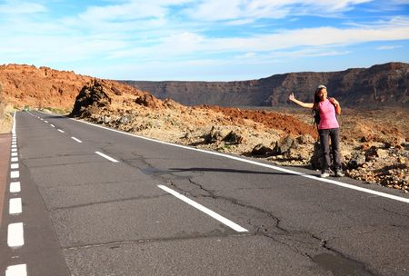 Woman Backpacking  Hitchhiking on Teide, Tenerife. Mixed chinese  caucasian model. photo
