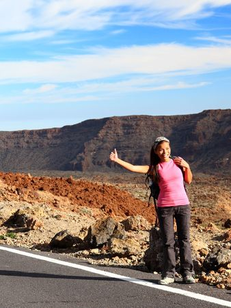 Girl Backpacking  Hitchhiking on Teide, Tenerife. Mixed chinese  caucasian woman model. photo