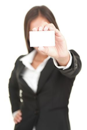 businesswoman card: Businesswoman in suit holding business card. Beautiful (really!) mixed chinese asian  caucasian business woman. Isolated on seamless white background.