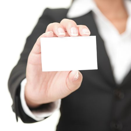 business card in hand: Business card closeup - businesswoman in black suit holding blank empty sign.