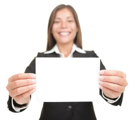 people holding sign: Businesswoman smiling holding empty blank sign. Excited version also available,  Beautiful mixed chinese asian  caucasian business woman. Isolated on seamless white background.
