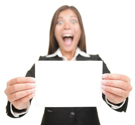 Business woman excited holding empty blank sign. Smiling version also available,  Beautiful mixed Chinese Asian  Caucasian businesswoman. Isolated on seamless white background.  photo