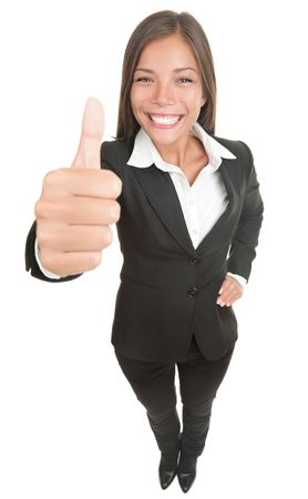 human thumb: Woman giving thumbs up to the camera, that is above in high angle view. Wide angle, almost fish eye. Smiling mixed chinese asian  caucasian business woman. Isolated on white.