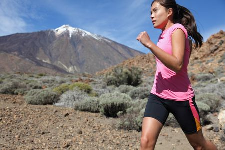 Runner. Woman running outside in beautiful nature. photo