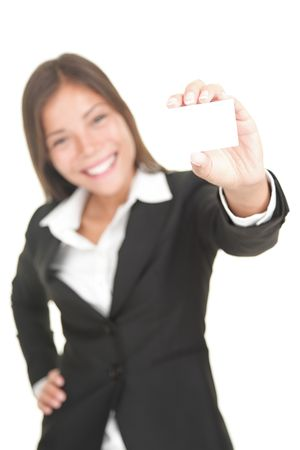 Business card woman. Businesswoman in her 20s showing blank sign isolated on white background. Stock Photo - 6764933