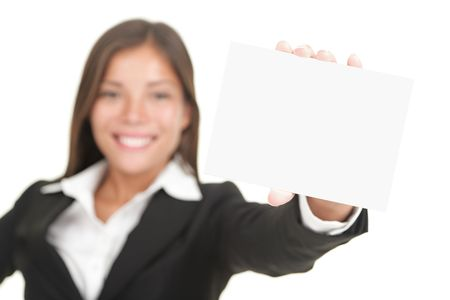 holding business card: Business sign. Beautiful smiling woman holding big business card  blank empty sign. Isolated on white background, focus on hand and card.