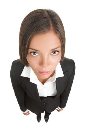 dull: Bored sad businesswoman isolated. Funny image of a young woman with a dull look staring at the camera. High angle view with near fish-eye effect. Isolated on white background.