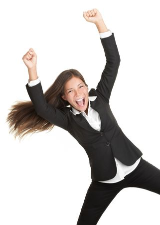 excited people: Cheerful celebrating success woman isolated. Young successful and very happy multiracial businesswoman with her arm in the air. Isolated on white background.