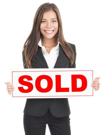 salesperson: Real estate agent showing sold sign. Isolated on white background. Mixed asian  caucasian woman.