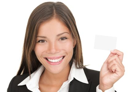 Business card woman. Businesswoman in her 20s showing blank business card sign isolated on white background. Young mixed race Chinese Asian  Caucasian model isolated on seamless white background. photo