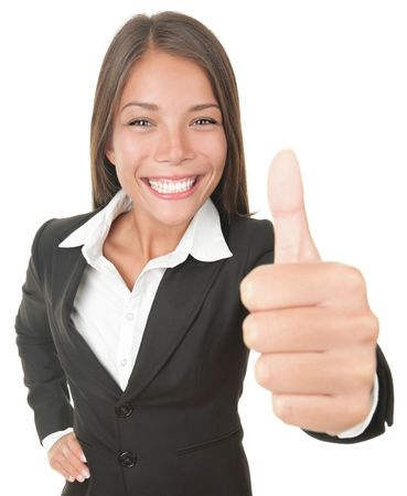 Success business woman isolated giving thumbs up looking at the camera. Successful happy Asian  Caucasian businesswoman. Isolated on white.  photo