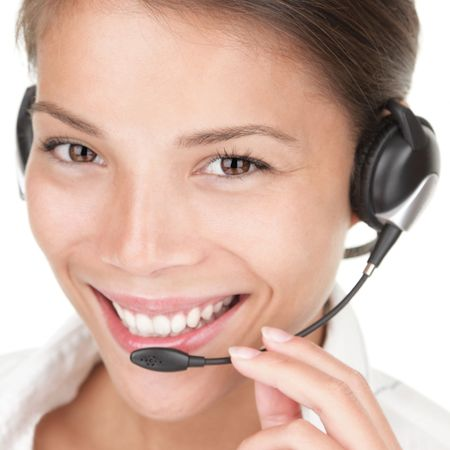 Telemarketing woman wearing headset on white background, photo