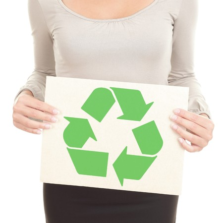 Recycling woman showing the recycle sign  symbol on recycled paper. Isolated on white background. photo