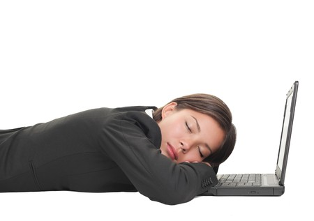 Tired overworked business woman sleeping on her laptop being exhausted from work, Beautiful mixed race Chinese Asian-Caucasian young businesswoman isolated on white and lying down on the floor.  photo