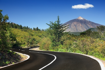 Open road on Tenerife. Winding mountain road in beautiful landscape on Tenerife showing the volcano Tiede.