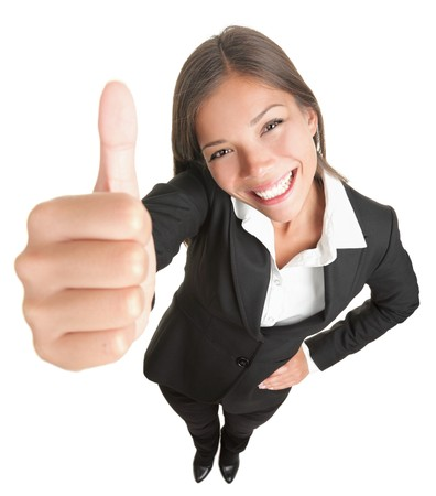 high angles: Success woman isolated giving thumbs up sign. Funny businesswoman in high and wide angle view. Mixed race Asian  Caucasian woman isolated on white background. Stock Photo