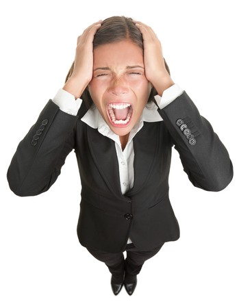 crazy woman: Screaming businesswoman in suit isolated on white background.