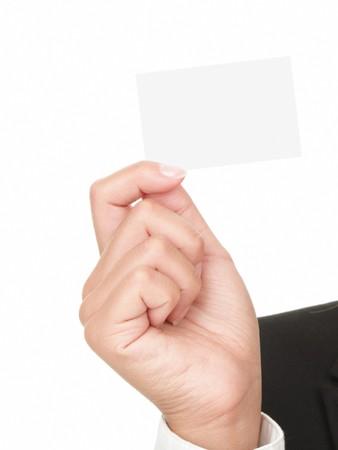 Detalle de la tarjeta de presentación en la mano de la mujer - aislada sobre fondo blanco.  Foto de archivo - 7351003
